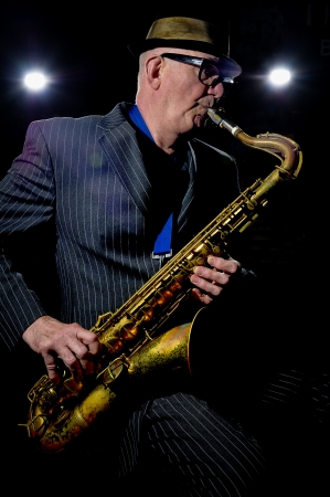 the tenor: Musician Bob Swift playing the tenor saxophone during a gig at the Greystones with his four-piece rhythm & blues band
