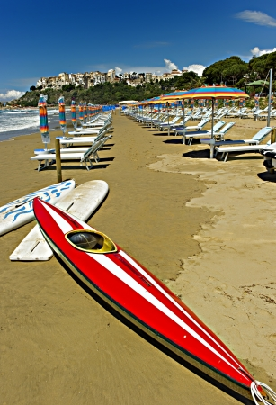 Red kayak on Sperlonga beach in Italy. photo