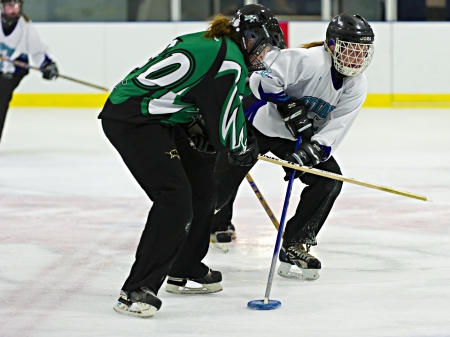 Ottawa's Hannah Barrie (right) during the Ottawa Belle under 19's 7-4 victory against Bonvital of Manitonba at the Sandy Hill Arena in Ottawa, December 1 2012.