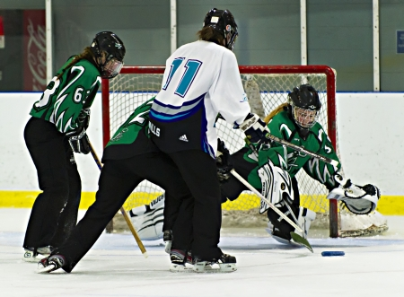 Ottawa's Nicole Mills (centre) shoots for goal during the Ottawa Belle under 19's 7-4 victory against Bonvital of Manitonba at the Sandy Hill Arena in Ottawa, December 1 2012.