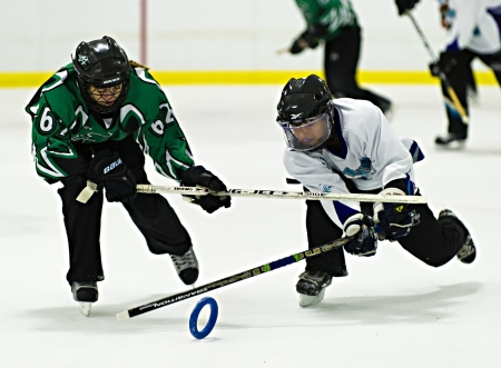 19's: Ottawas Nicole Mills (right)  during the Ottawa Belle under 19s 7-4 victory against Bonvital of Manitonba at the Sandy Hill Arena in Ottawa, December 1 2012. Editorial