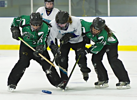 19's: Ottawas Victoria Maziekis (centre) during the Ottawa Belle under 19s 7-4 victory against Bonvital of Manitonba at the Sandy Hill Arena in Ottawa, December 1 2012. Editorial
