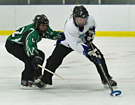 19's: Ottawas Nicole Mills (right) during the Ottawa Belle under 19s 7-4 victory against Bonvital of Manitonba at the Sandy Hill Arena in Ottawa, December 1 2012.