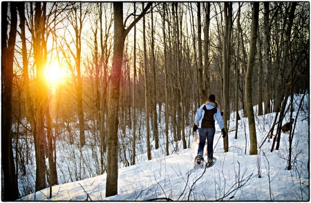 Snowshoeing in Canada at sunset