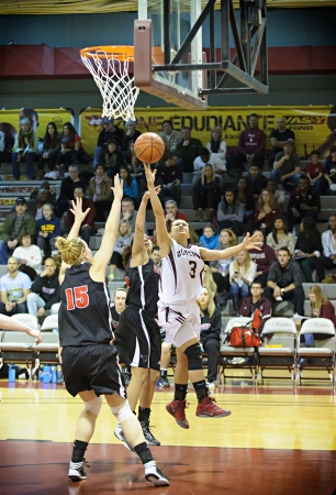 OTTAWA - MARCH 2: Ottawas Julia Soriano (right) shoots during the OUA East Final against Carleton on March 2 2013 in Ottawa, Canada. Carleton won 50-43 to progress to the CIS Final 8.