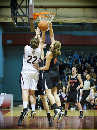 OTTAWA - MARCH 2: Carletons Lindsay Shotbolt (right) blocks a shot by Ottawas Jenna Gilbert (left) during the OUA East Final on March 2 2013 in Ottawa, Canada. Carleton won 50-43 to progress to the CIS Final 8.