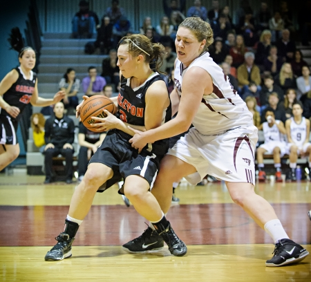 OTTAWA - MARCH 2: Carletons Lindsay Shotbolt (left) shields the ball from Ottawas Jenna Gilbert (left) during the OUA East Final on March 2 2013 in Ottawa, Canada. Carleton won 50-43 to progress to the CIS Final 8.