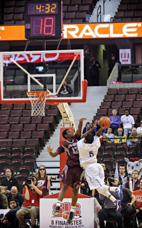 OTTAWA - MARCH 9: Ottawa Gee-Gees Caleb Agada (left) gets in a defensive block against Nate Wainwright (right) of the Lakehead Thunderwolves during their match at Scotiabank Place, Ottawa on March 9 2013 during the 2013 Mens CIS basketball Finals.