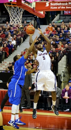 OTTAWA - MARCH 10: Clinton Springer-Williams (right) in action for the Carleton Ravens in their match against Lakehead Thunderwolves at Scotiabank Place, Ottawa on March 10 2013 during the 2013 Mens CIS basketball Finals.