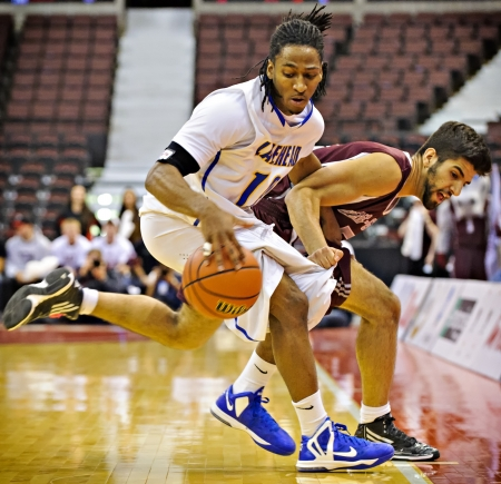 OTTAWA - MARCH 9: Gregg Cater (left) of the Lakehead Thunderwolves and Mehdi Tihani of the Ottawa Gee-Gees in action at Scotiabank Place, Ottawa on March 9 2013 during the 2013 Mens CIS basketball Finals.