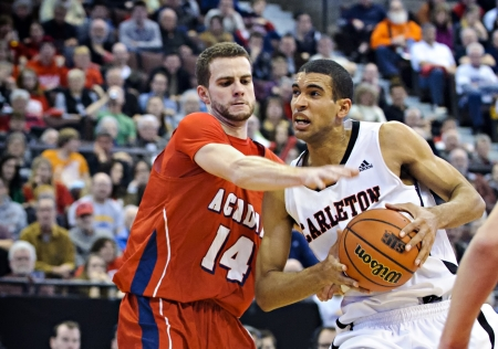 OTTAWA - MARCH 9: Thomas Scrubb (right) in action for the Carleton Ravens in their match against Acadia Axemen at Scotiabank Place, Ottawa on March 9 2013 during the 2013 Mens CIS basketball Finals.