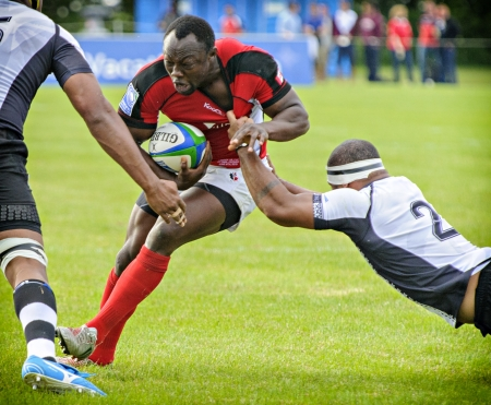 fijian: Canadas Nanyak Dala tackled by Fijian Malakai Ravulo during the IRB Pacific Nations Cup match against Fiji held at the Twin Elm rugby park in Ottawa, Canada on June 5, 2013.
