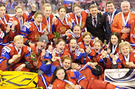 OTTAWA - APRIL 9: Members of Team Russia celebrate after winning bronze at the IIHF Women