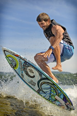 skim: Canadian Dominic Lagacé competes in the 1st annual Calabogie Wake Surf Championship held on Calabogie Lake, Ontario, Canada on July 12 2013. Dominic finished 3rd in both the Pro Mens Skim and Surf competitions. Editorial