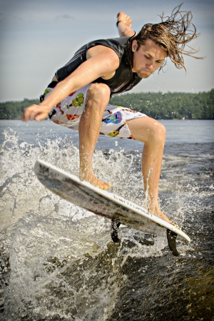 competes: Canadian Chris Hau competes in the 1st annual Calabogie Wake Surf Championship held on Calabogie Lake, Ontario, Canada on July 12 2013. Editorial