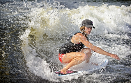 skim: Canadian Caroline Villeneuve competes in the 1st annual Calabogie Wake Surf Championship held on Calabogie Lake, Ontario, Canada on July 12 2013. Caroline finished 1st in the Pro Womens Skim competitions.