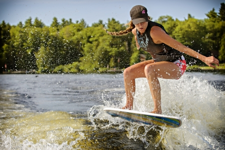 Canadian Caroline Villeneuve competes in the 1st annual Calabogie Wake Surf Championship held on Calabogie Lake, Ontario, Canada on July 12 2013. Caroline finished 1st in the Pro Womens Skim competitions.