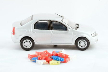Spare fuses and toy car in the background. Stock Photo