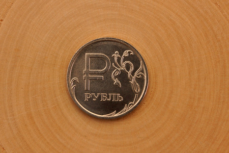 redesign: Redesined Russian Ruble Coin on Wood Background Stock Photo
