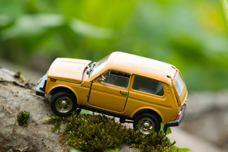suv: Old yellow SUV directed uphill
