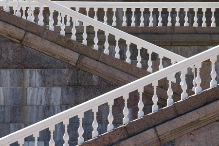 balustrade: Side view of white balustrade and marble walls
