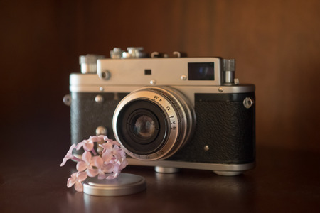 rangefinder: Image of rangefinder film camera ready for flower macro shot Stock Photo