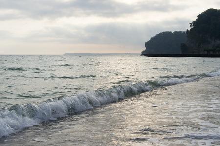 breaking: Blue waves breaking near a sea shore Stock Photo