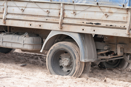 wheelspin: Close up image of a truck wheels slipping in sand Stock Photo