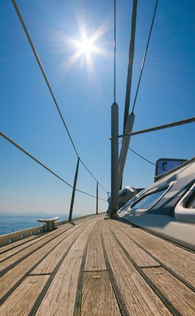 ship bow: Sailboat deck with sun and blue sky