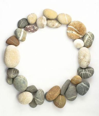 group photo: Circle border of sea stones colored on white Stock Photo