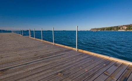 slovenia: wooden pier with adriatic sea in slovenia on a clear sunny day