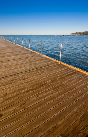 wooden pier with adriatic sea in slovenia on a clear sunny day Stock Photo - 13612854