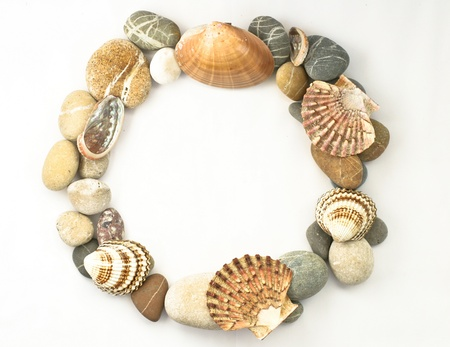 nature picture: Circle border of sea stones colored on white Stock Photo