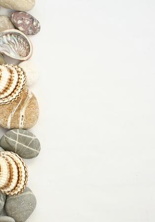 Sea stones colored border with seashell Stock Photo - 13612607