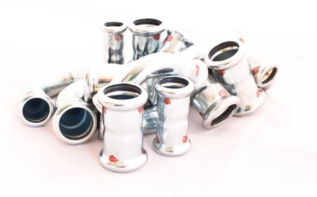inox stainless steel instalation fittings for industry and house instalations on bright background photo