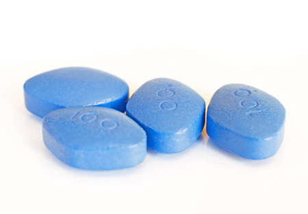 Blue pills for erectile dysfunction treatment, white background, close-up, shallow DOF Imagens