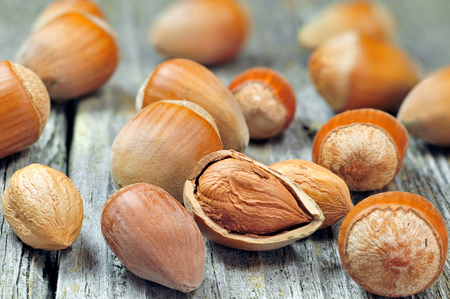 cobnut: Close up photo of hazelnuts on a wooden table