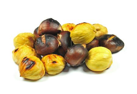 fagaceae: Close up photo of roasted chestnuts on white background Stock Photo