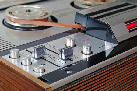 tape player: Close up photo of old reel to reel tape player