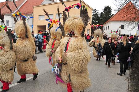 shrove: Ptuj, Slovenia - February 7, 2016 - Traditional carnival on shrove sunday with traditional figures, known as kurent or korent in Ptuj, Slovenia Editorial