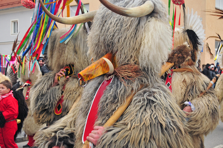 shrove: Ptuj, Slovenia - February 7, 2016 - Traditional carnival on shrove sunday with traditional figures, known as kurent or korent in Ptuj, Slovenia Editorial