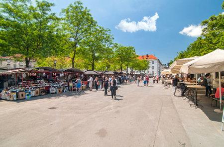 central market: Ljubljana, Slovenia - June 7, 2016 People walking and shopping in Ljubljanas central market on a bright sunny day