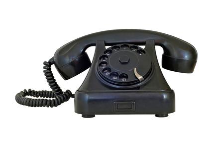 old fashioned rotary phone: Old vintage black telephone, isolated on white Stock Photo