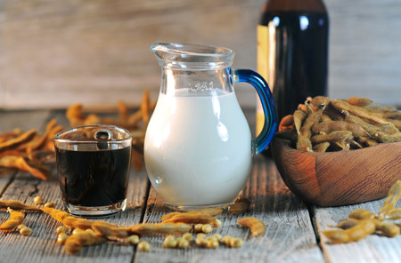 soja: Glass of soybean milk and sauce on a wooden table Stock Photo