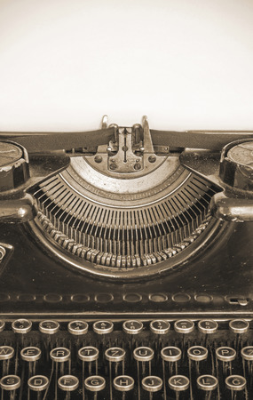 Old typewriter and blank sheet of paper for your text, sepia style