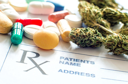 Close up of prescription pills with medical cannabis and prescription paper
