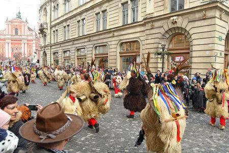 Ljubljana, Slovenia - February 10, 2018 - Traditional carnival on shrove Saturday with traditional figures, known as kurent or korent in Ljubljana, Slovenia