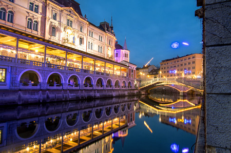 Ljubljanica river and Triple bridges in the background, illuminated for Christmas and New Year's celebration, Ljubljana, Slovenia Фото со стока - 119859972