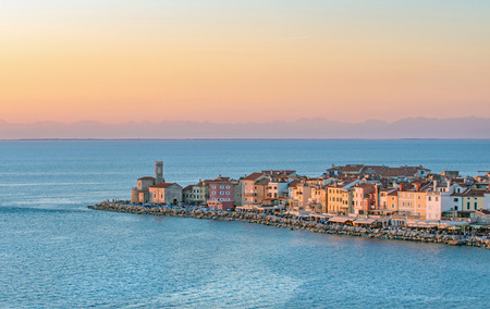 View of old coastal town Piran and adriatic sea, lit by warm evening light, Slovenia
