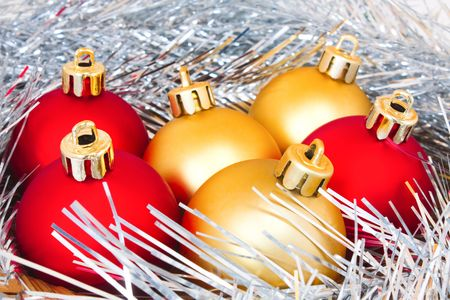 red and gold balls in tinsel Stock Photo